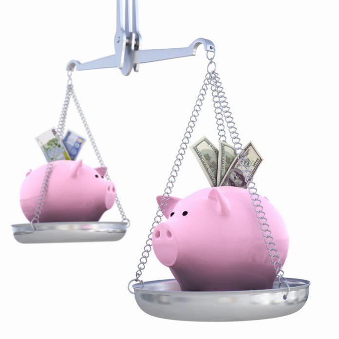 piggy banks on a balance scale