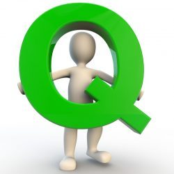 Person holding a Q